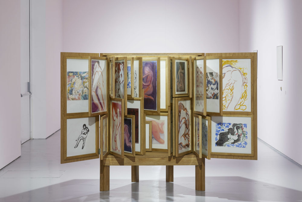 Alex Cecchetti, Erotic Cabinet (2016-2017) 69 works mixed techniques, furniture in solid oak wood, frames, poems disguised as paintings. Installation view, At the Gates of the Music Palace (2018) Spike Island. Photograph by Lisa Whiting