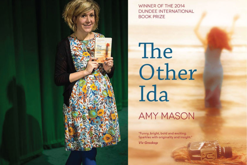 A photograph of the author Amy Mason next to her book The Other Ida.