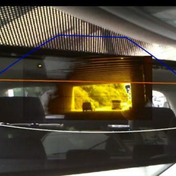 Photograph: A car window overlaid with a diagram of a pyramid.