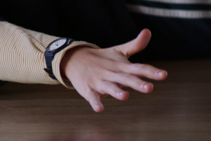 Film still: A stretched out hand