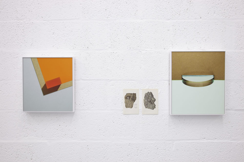 Installation view of Suzanne Mooney, The Edge of Collapse (2011). Four graphic images hang on white walls.