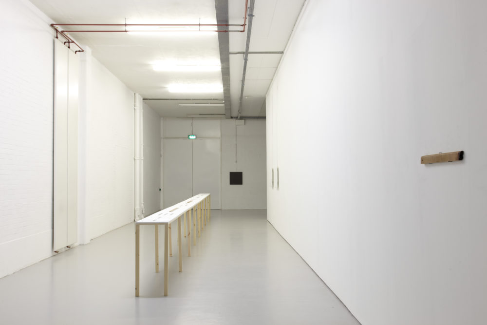 Installation: Cevdet Erek's Alt Üst installed at Spike Island. The gallery walls are white, and a long white table-like structure stretches down the corridor like gallery.
