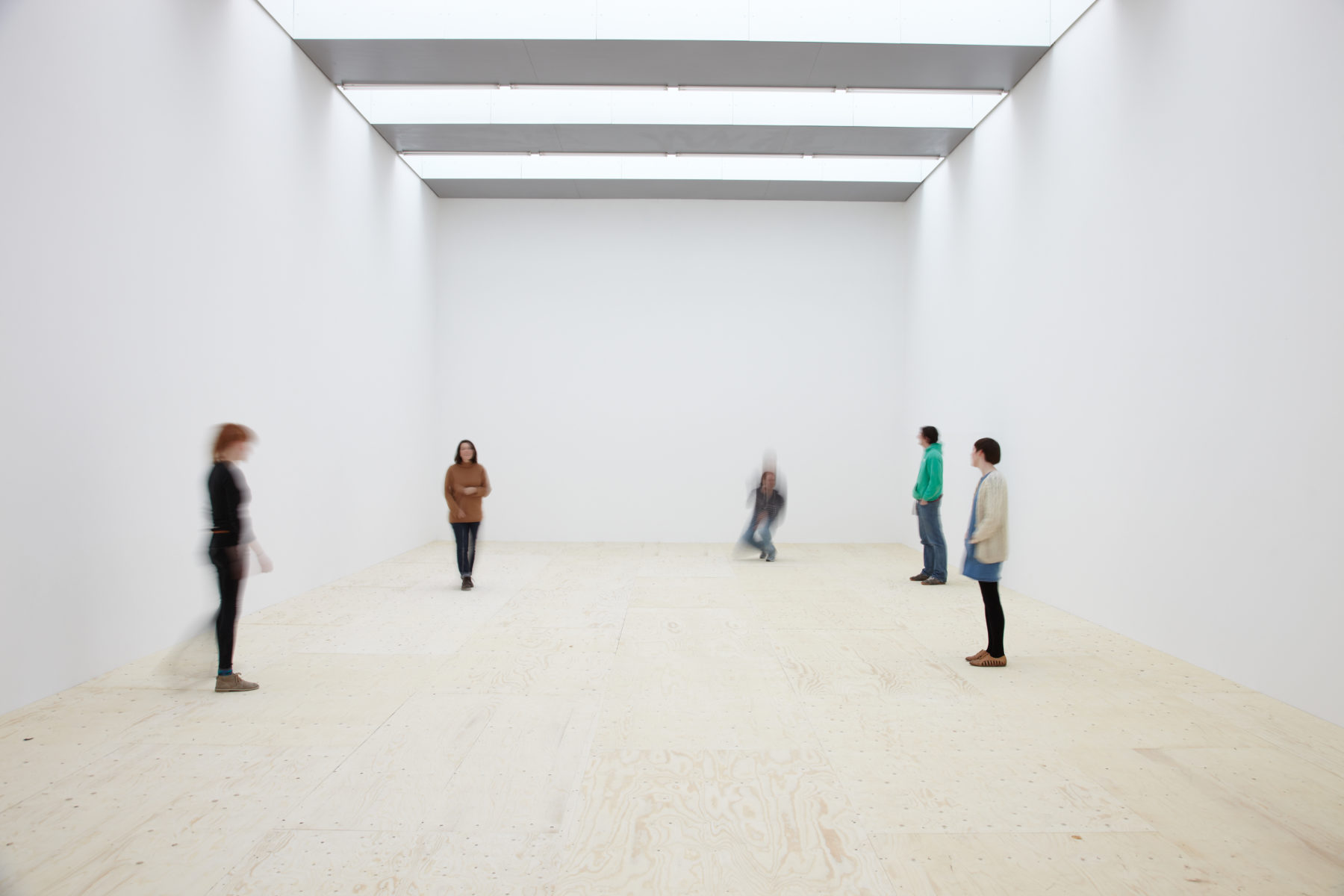 Installation: Visitors stand in the gallery that looks almost empty.