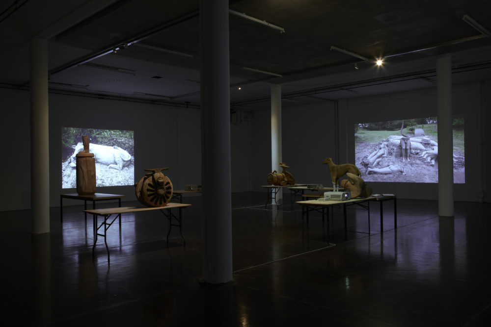 Installation view of Crêpe Suzette, (2012). Projections of outdoor sculptures are surrounded in the gallery by various wooden sculptures.