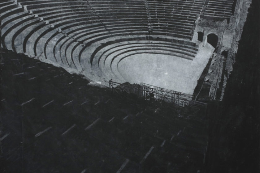 A print of a photograph of an amphitheater. The print is made from chalk on blackboard.