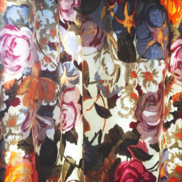 Colourful floral fabric is photographed in a drape.
