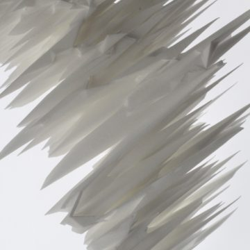 A sculpture of glass and nylon that has been manipulated to create spikes.