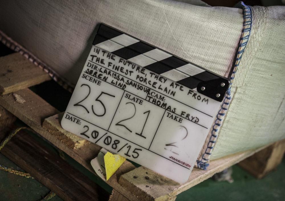 Production shot: A clapboard shows
