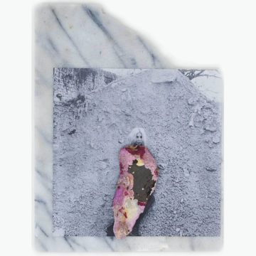 A portrait of a woman against a grey rock - the woman's face is in greyscale. Her body has been covered by what looks like a pink gemstone. This central image is positioned on a piece of smooth marble.