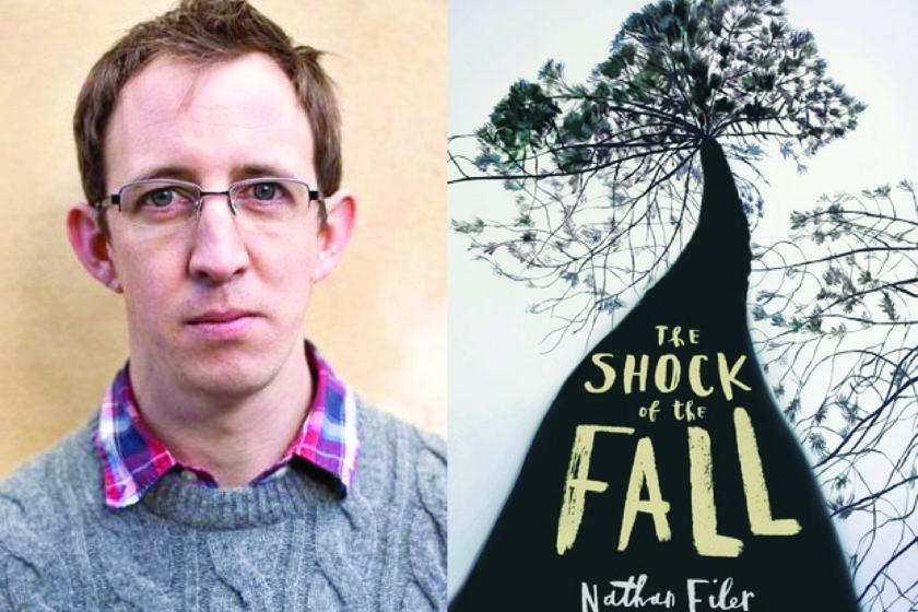 A photograph of the author Nathan Filer next to his book The Shock of the Fall.