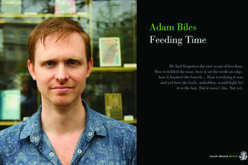 A photograph of the author Adam Biles next to their book Feeding Time.