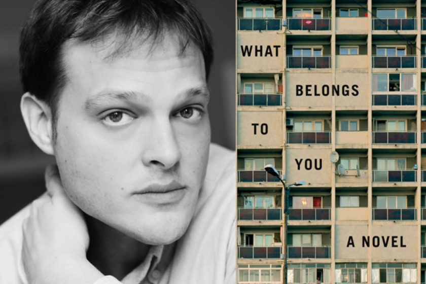 A photograph of the author Garth Greenwell next to their book What Belongs To You.
