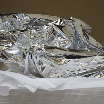 Photograph: Aluminum foil is crinkled atop sheets of tissue paper and bubblewrap.
