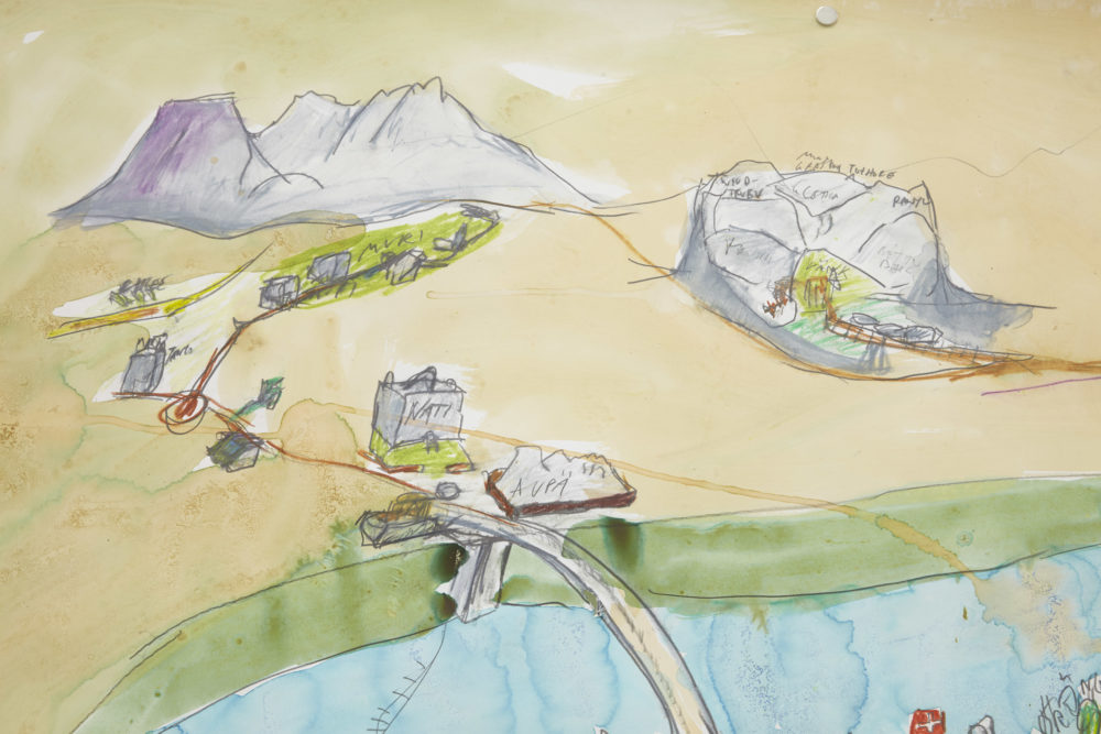 A hand drawn and painted map - two mountains are visible and a bridge over a river.