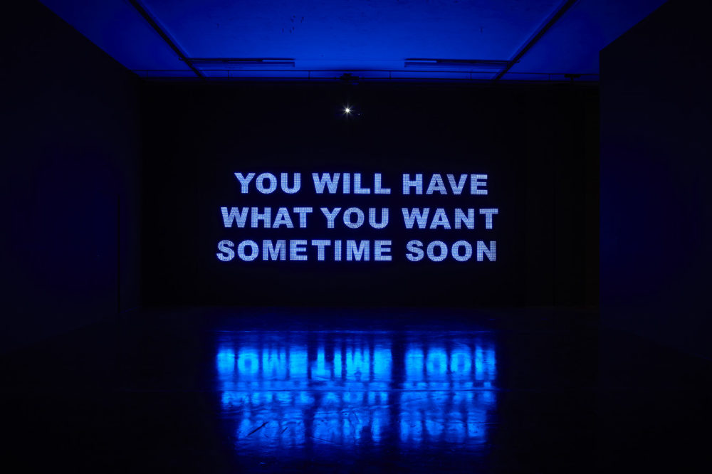 Installation view of Savage, You Will Have What You Want Sometime Soon (2011). A projection of