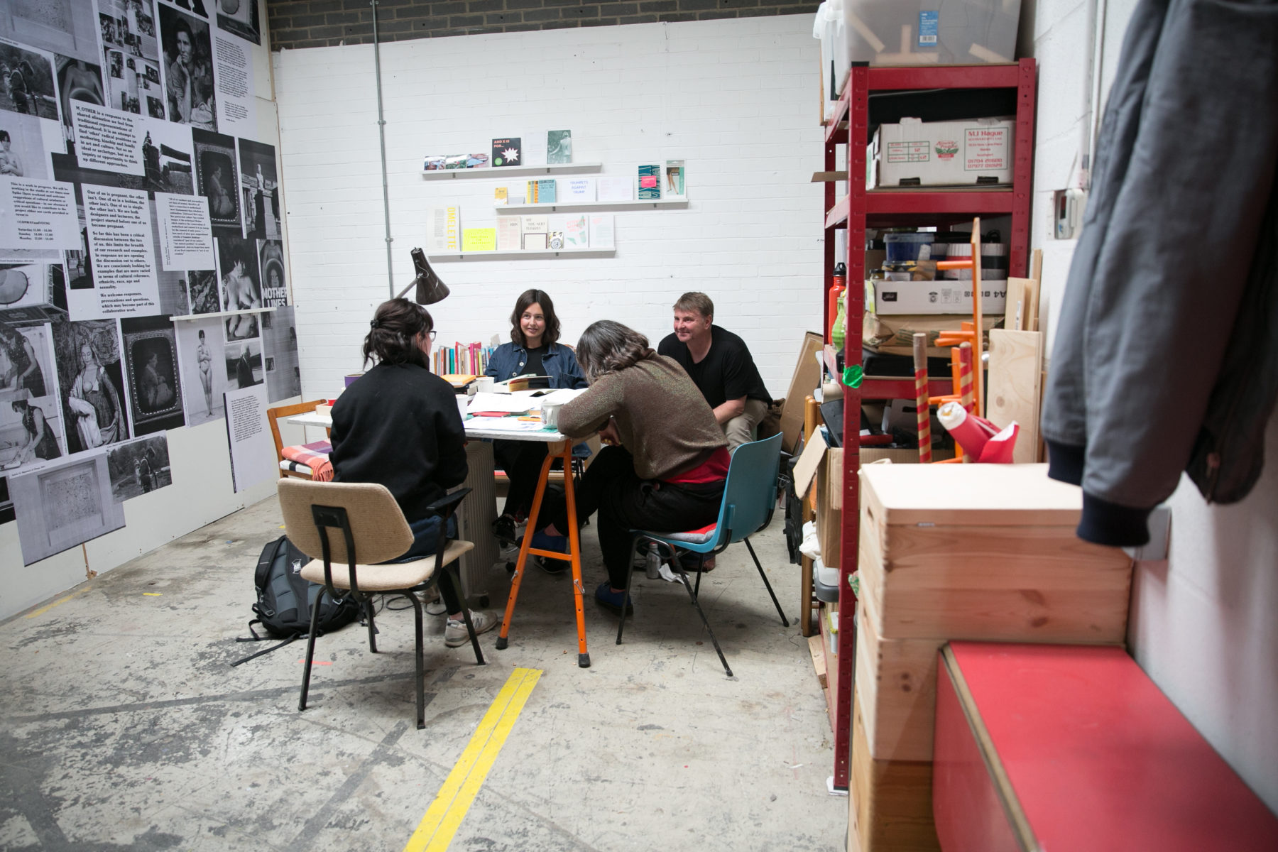 Artists Conway and Young host a meeting in their studio.