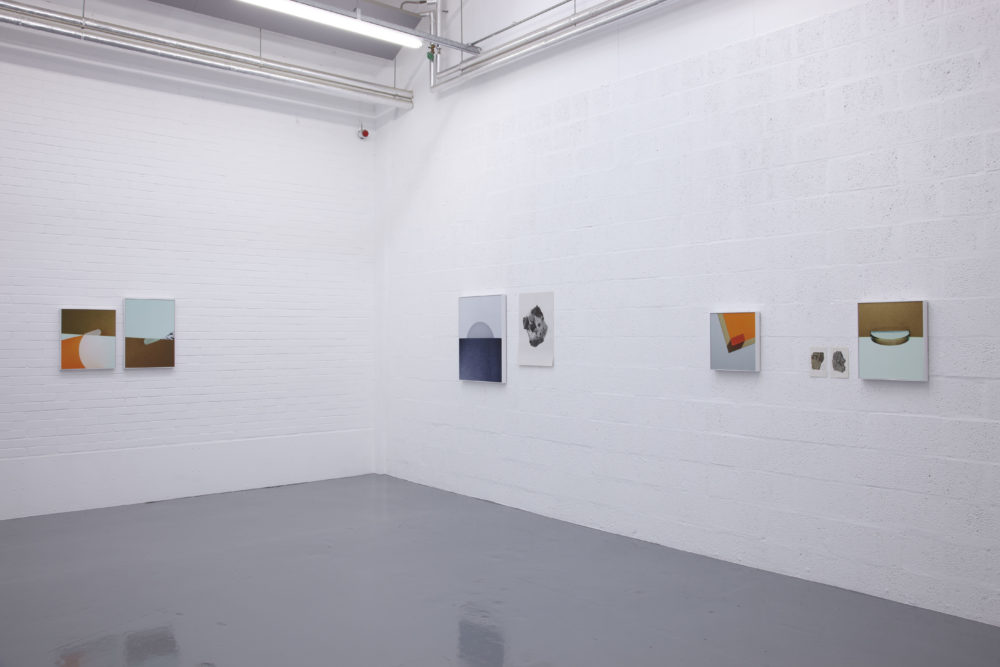 Installation view of Suzanne Mooney, The Edge of Collapse (2011). The gallery is painted white. Six graphic art images hang on the walls.