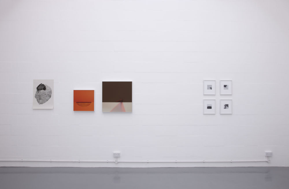 Installation view of Suzanne Mooney, The Edge of Collapse (2011). The gallery is painted white. Seven graphic art images hang on the walls.