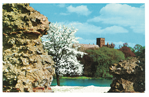 A work from The Artists' Postcard Show (2012). A snow covered tree is collaged into a sunny photograph of a church.