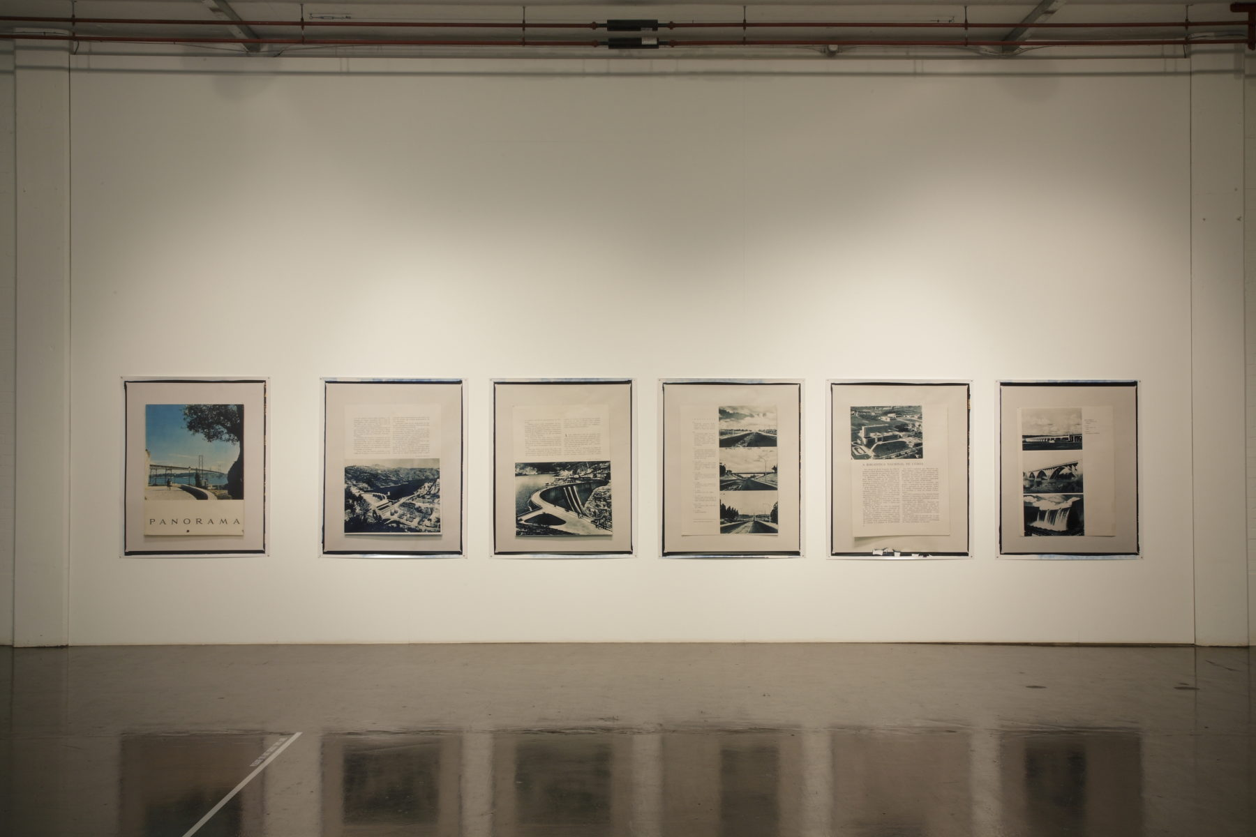 Installation view of Part-ilha, A River Ain't Too Much to Love (2011). Six framed images hang in the gallery. The images are accompanied by text that is too far away to read.