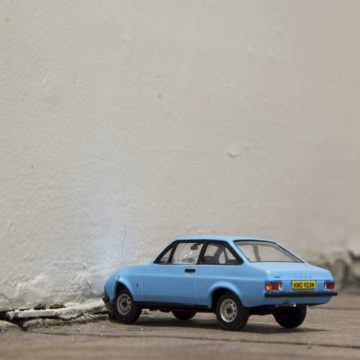 Photograph: A toy car has been crashed into a wall.