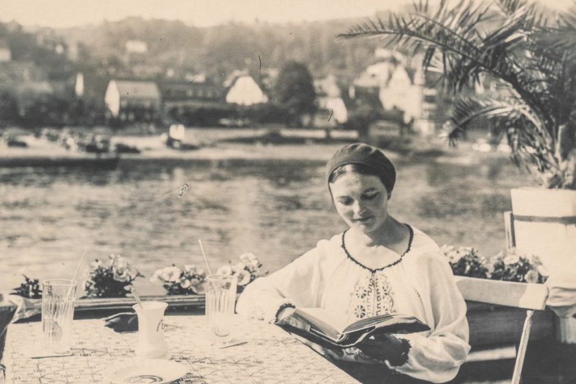 Woman reading a book outside. Zelda Fitzgerald event at Spike Island, Bristol