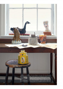 Inside page of The World of Interiors magazine, featuring a variety of artists' editions displayed on table tops and a windowsill in a well lit room