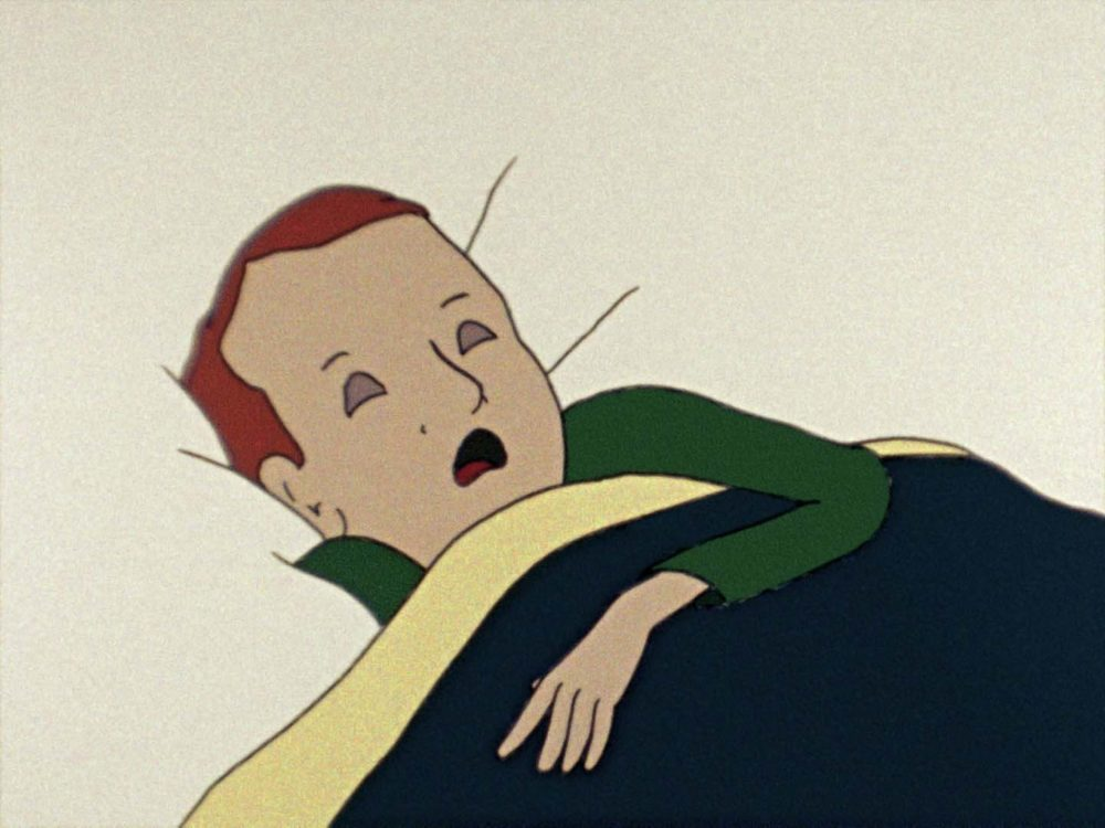 Film still of a cartoon character sleeping in bed. Their eyes are closed and their mouth is open, one arm is sticking outside of the navy blue bedsheet.