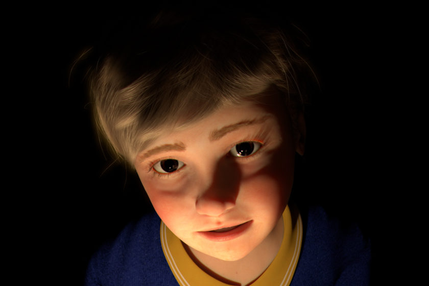 A head shot of a CGI young boy. He has fair hair, brown eyes, slightly rosy cheeks and is wearing a blue sweater over a yellow shirt. The background is black and his face is lit dramatically from below.