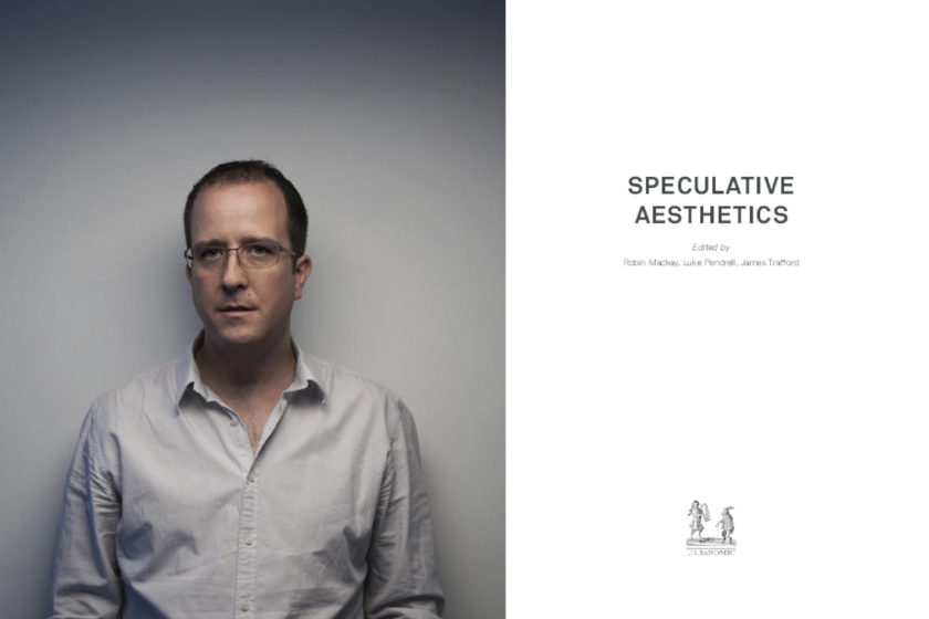 Photograph of Robin Mackay in a grey shirt looking forwards at the camera. He stands in front of a grey background. On the right is a white book cover with simple text on the cover which reads: Speculative Aesthetics, and beneath: Edited by Robin Mackay, Luke Pendrill, James Trafford