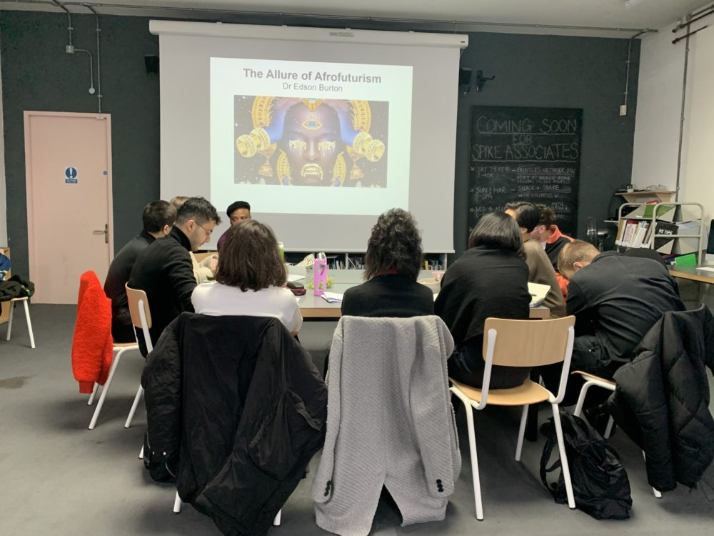The participants receive a lecture on Afrofuturism