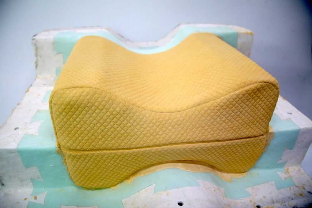 A studio process revealing a yellow plaster cast of an orthopedic cushion