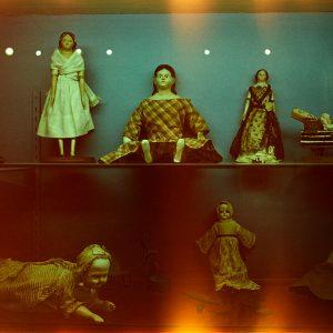 photograph of a vitrine with life-like dolls inside